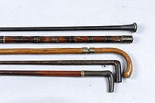 A 7MM WALKING STICK GUN 27-inch barrel; together with two antique sword sti