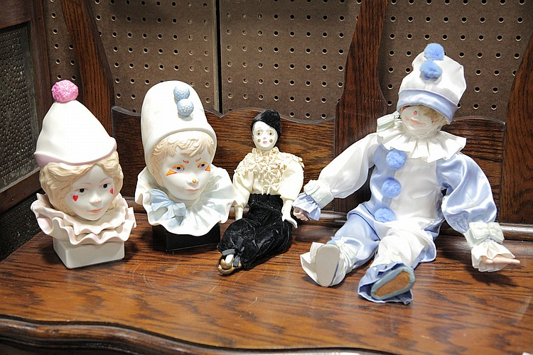 FOUR PORCELAIN CLOWNS.