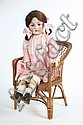BISQUE HEAD DOLL AND CHAIR. A signed JDK #214 bisque head doll in a pink and white dress. 31