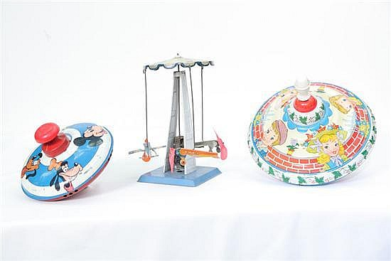THREE TIN WIND UP TOYS. Two tops, one by the Ohio Art Company, 8