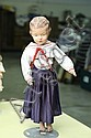 SCHOENHUT DOLL. Wood jointed doll with carved hair, intaglio eyes and original clothes. Impressed signature. 19