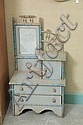 CHILD'S DRESSER. Blue and gray paint decorated chest with stick and ball decoration, mirror, upper door and two drawers on bracket f..