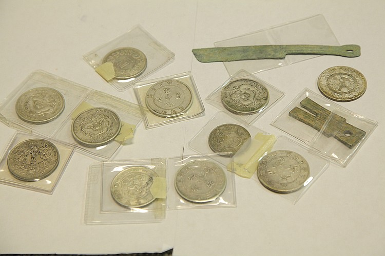 ELEVEN CHINESE COINS.