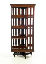 MISSION-STYLE REVOLVING BOOKCASE.