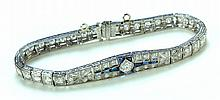 LADIES PLATINUM, DIAMOND AND SAPPHIRE BRACELET.