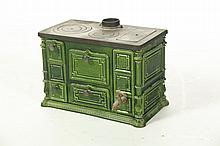 CAST IRON GREEN ENAMELED CHILD'S STOVE.