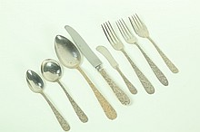 SET OF SILVER FLATWARE.