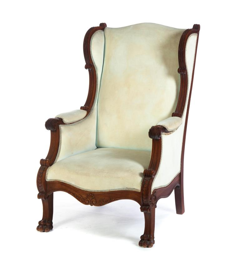 AMERICAN CARVED ARMCHAIR.