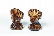 PAIR OF ROCKINGHAM FIGURAL WINDOW STOPS.