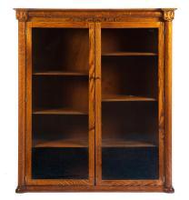 DOUBLE-DOOR OAK LIBRARY BOOKCASE.