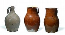 THREE INCISED STONEWARE JUGS.