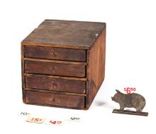 CASE OF FOUR DRAWERS AND CUTOUT SMALL TIN PIG.