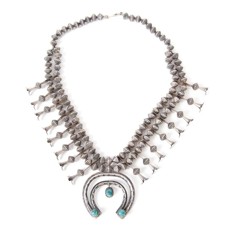 NAVAJO SILVER AND TURQUOISE SQUASH BLOSSOM NECKLACE.