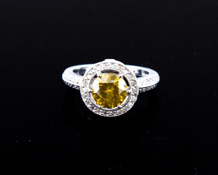 WHITE GOLD AND FANCY YELLOW GREEN DIAMOND RING.
