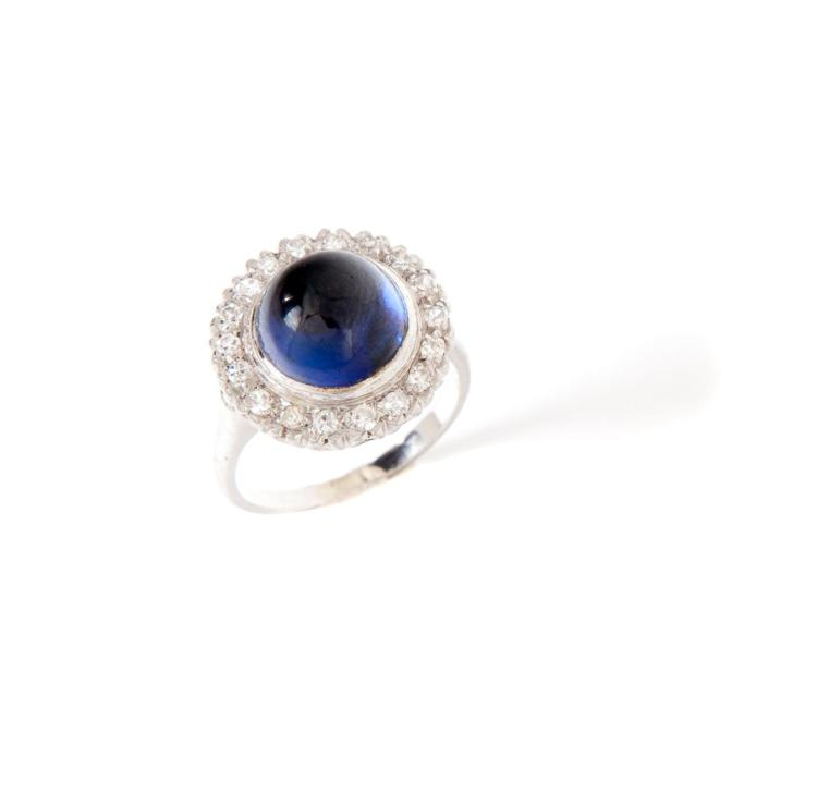 CABOCHON BLUE SAPPHIRE AND DIAMOND RING.