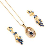 GOLD, SAPPHIRE AND DIAMOND PENDANT AND EARRINGS.