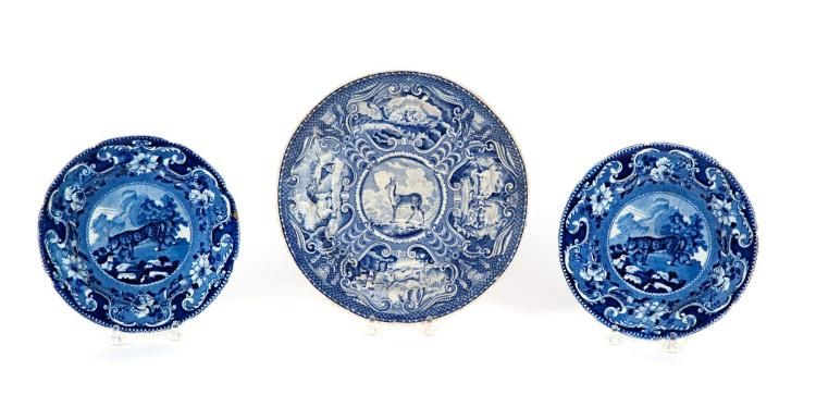 THREE BLUE AND WHITE STAFFORDSHIRE PLATES WITH ANIMALS.