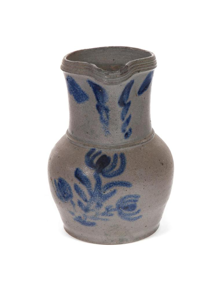 SMALL STONEWARE PITCHER WITH FREEHAND COBALT DECORATION.