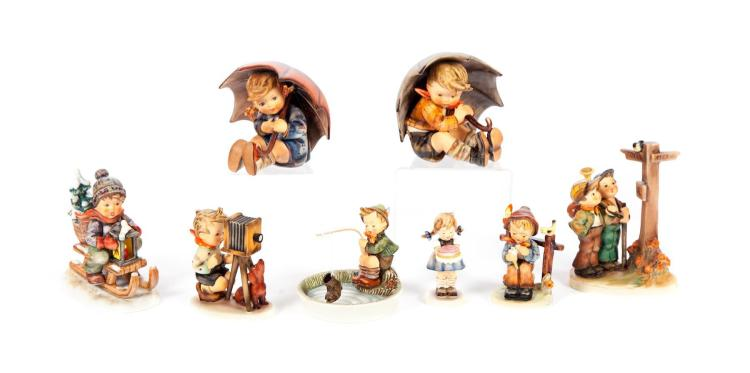 EIGHT HUMMEL FIGURINES.