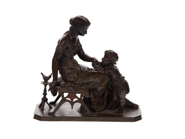 BRONZE FIGURAL GROUP OF MOTHER TENDING TO HER YOUNG SON.