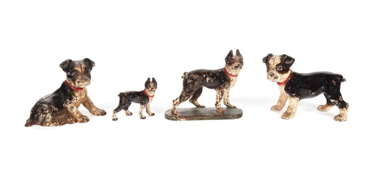FOUR CAST IRON TERRIERS.