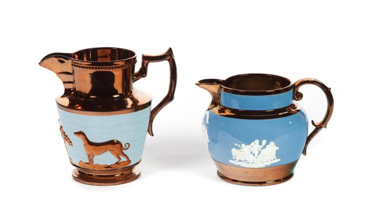 TWO COPPER LUSTRE PITCHERS WITH LIGHT BLUE BANDS.