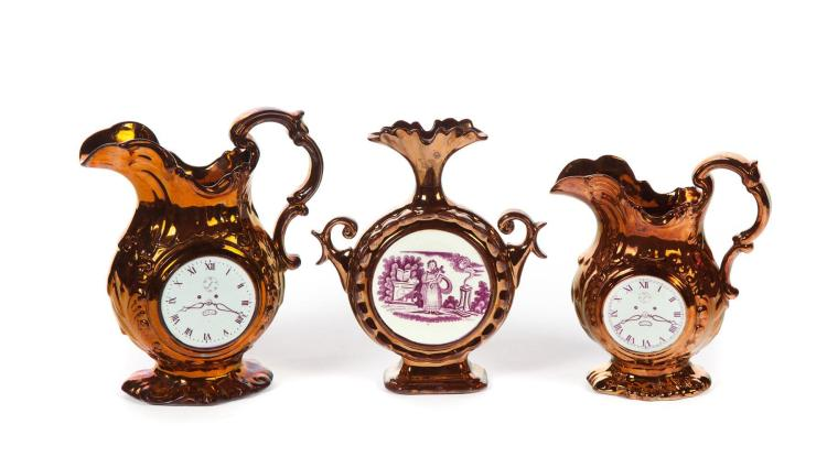 THREE COPPER LUSTRE VESSELS WITH CLOCK FACES.