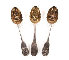 THREE STERLING SILVER SERVING SPOONS WITH LONDON HALLMARKS.