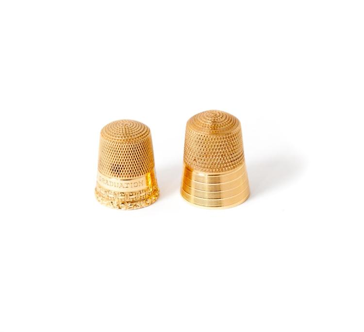 TWO GOLD THIMBLES.