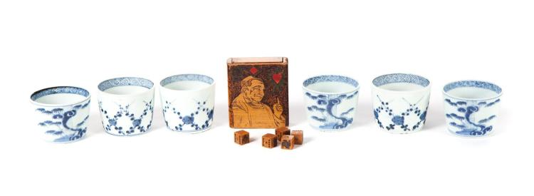 SIX ASIAN BLUE AND WHITE HANDLELESS CUPS AND A PRIMITIVE DICE GAME.