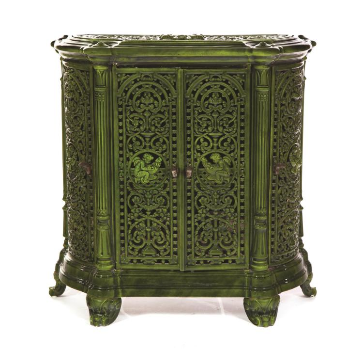 ORNATELY CAST GREEN ENAMEL IRON STOVE.