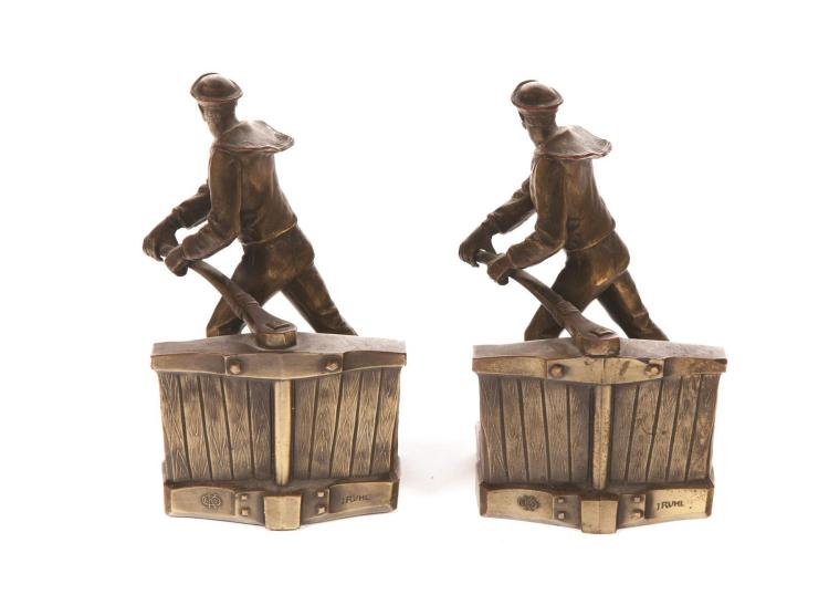 PAIR OF BOOKENDS MANUFACTURED BY THE KRONHEIM & OLDENBUSCH AND ARTIST SIGNED AFTER J. RUHL.