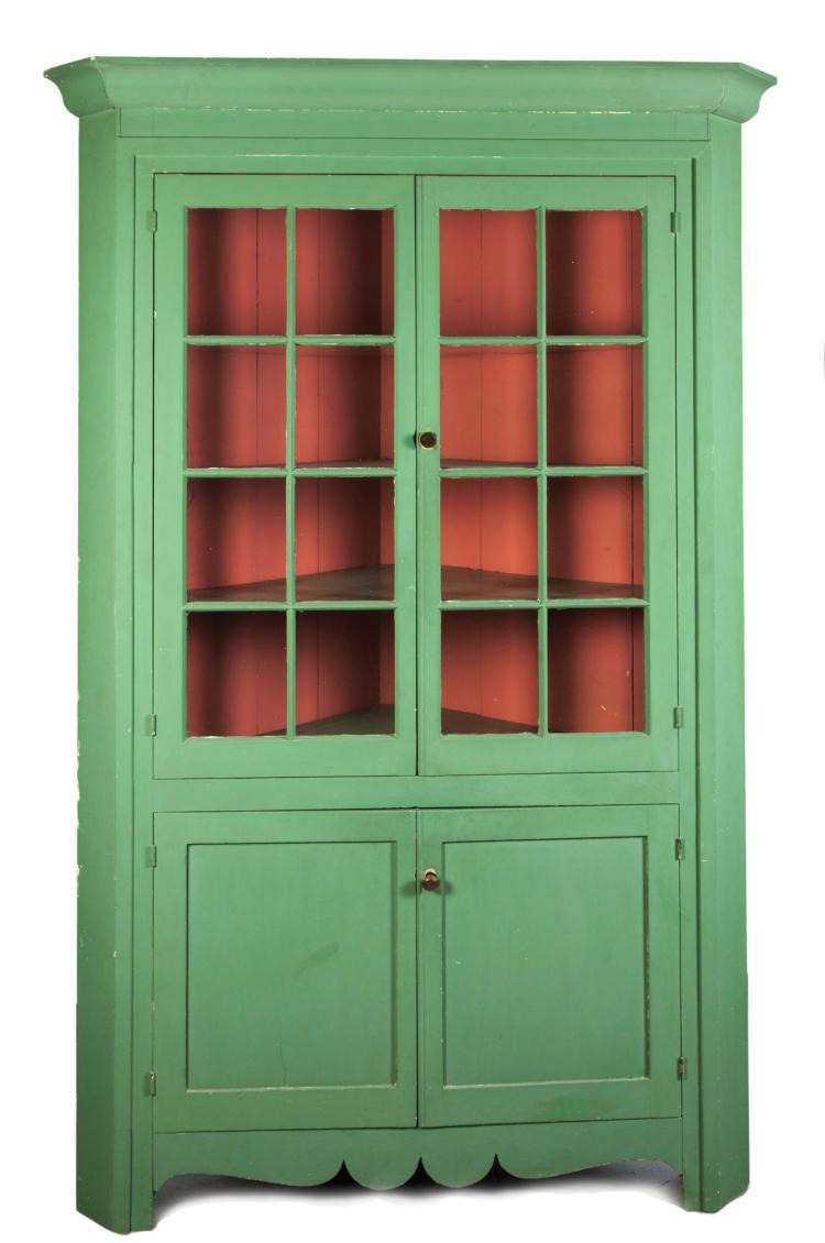 PAINTED ONE-PIECE SIXTEEN-PANE CORNER CUPBOARD.