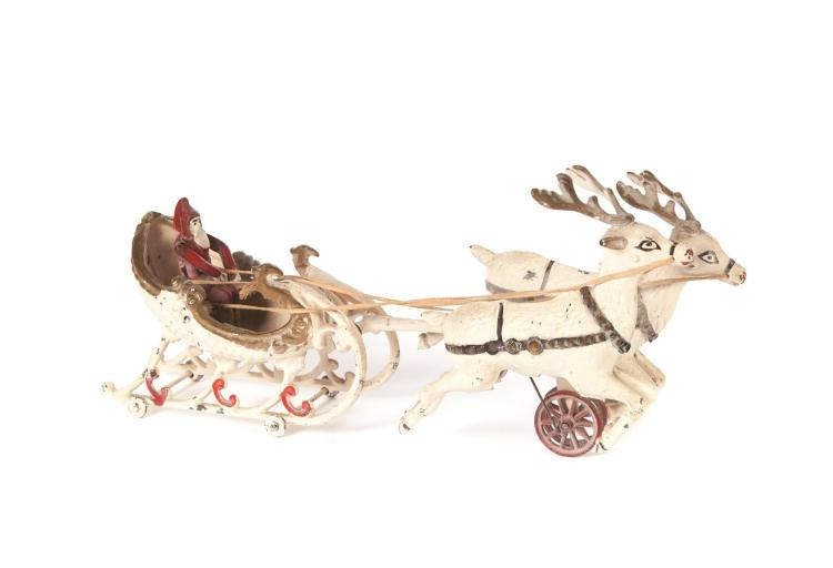 CAST IRON SANTA''S SLEIGH PULLED BY TWO REINDEER.