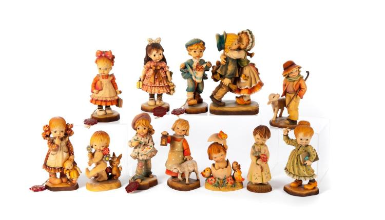 TWELVE ANRI WOOD CARVED FIGURINES.
