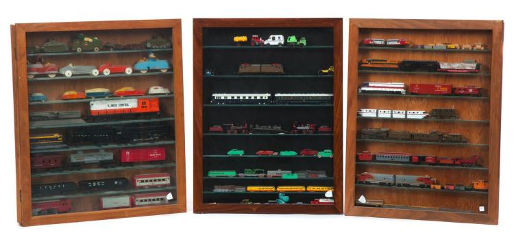 THREE WALL HANGING DISPLAY CASES OF MODEL AND TOY CARS AND TRAINS.