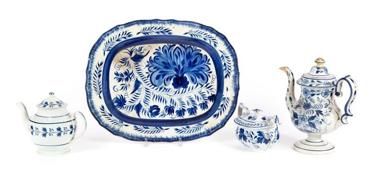 FOUR PIECES OF EARTHENWARE WITH COBALT DECORATIONS.