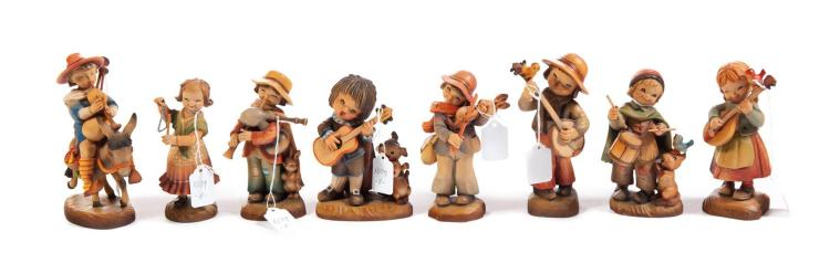 EIGHT ANRI WOOD CARVED MUSICAL INSTRUMENT-THEMED FIGURINES.