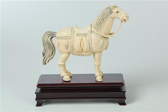 CARVED IVORY HORSE.
