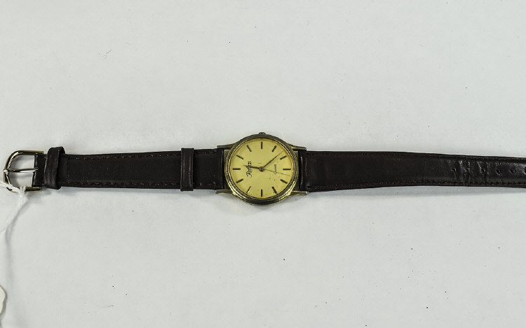 A Gents Gold Colour Wristwatch on a Brown Leather