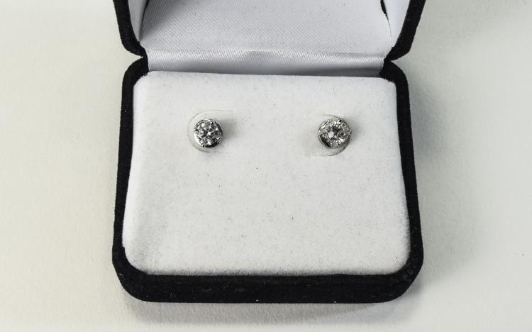 Ladies Pair of Diamond Earrings. The Round Cut Dia