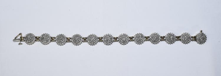A 9ct Gold and Diamond Bracelet - Set with 12 Circ