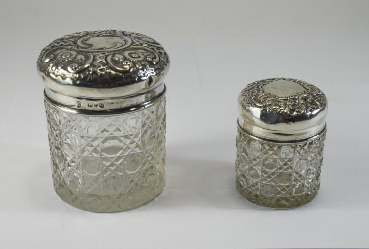 Victorian Matched Pair of Embossed Silver Topped C