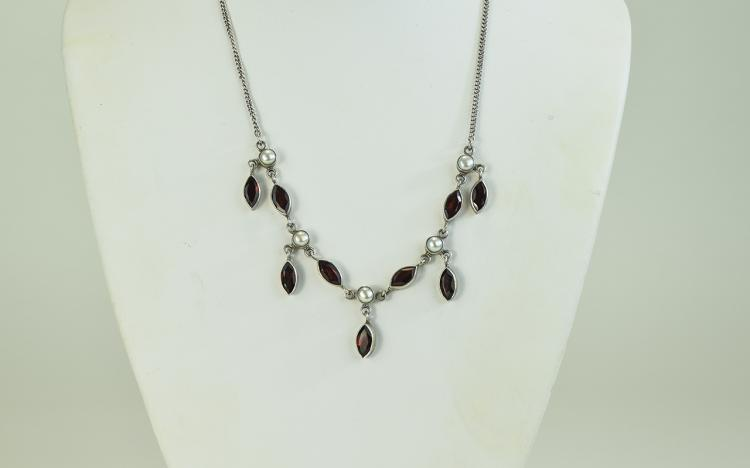 A Vintage Silver Necklace Set with Garnets and Pea