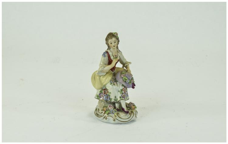 Sitzendorf Figure of a Young Woman, seated, in 18t
