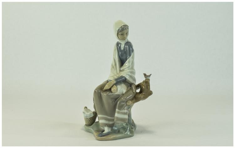 Lladro Figure ' Girl Sitting Watching Bird on Bran