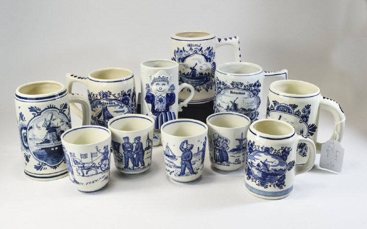 A Collection of Dutch Delft Hand Painted Mugs and