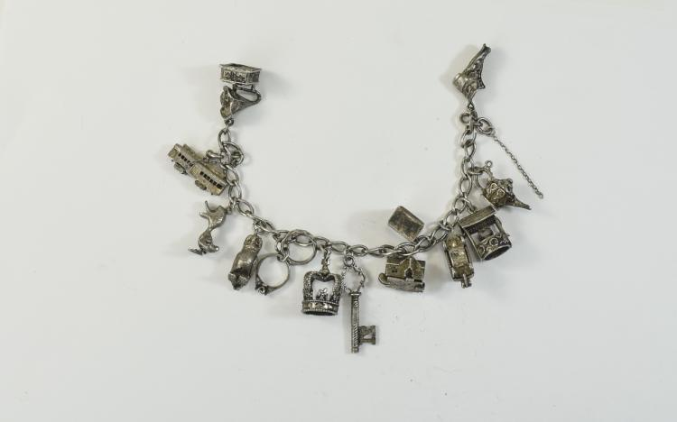 A Silver Charm Bracelet, Loaded with 13 Good Quali