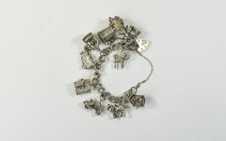 A Silver Charm Bracelet Loaded with 10 Silver Char