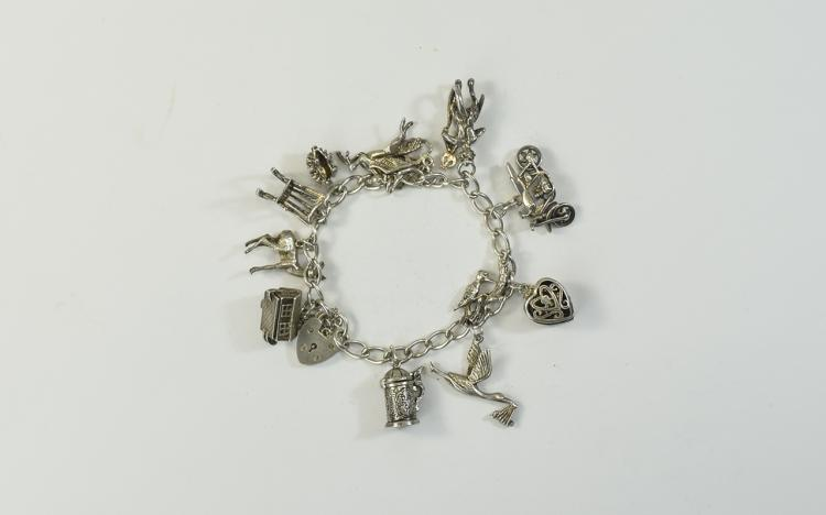 A Vintage Silver Charm Bracelet Loaded with 12 Exc